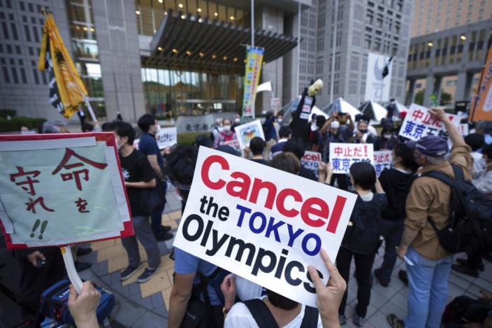 6月23日,東京有示威者上街反對舉行東京奧運。AP