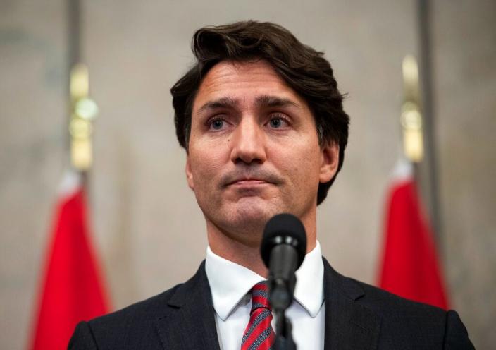 加拿大總理杜魯多表示,被中國拘押的兩名加拿大公民斯帕弗、康明凱正返國。AP圖片
