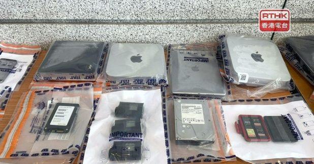 警方檢獲多部電腦和手提電話,以及拍攝工具等。(實習記者胡志城攝)